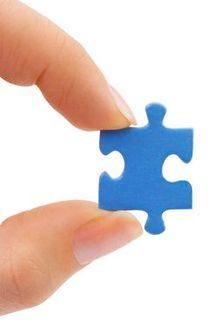 Holding puzzle piece - left side